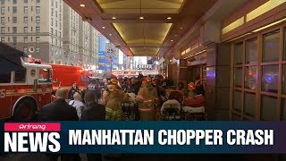 Helicopter crashes into New York skyscraper, killing one