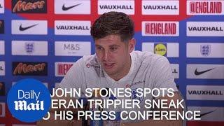 John Stones spots Kieran Trippier sneak into his press conference