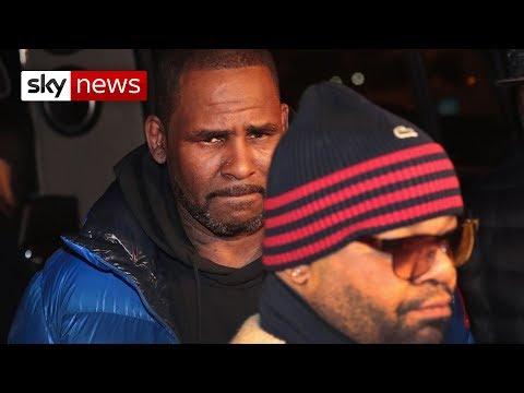 Singer R Kelly arrested after handing himself in to police