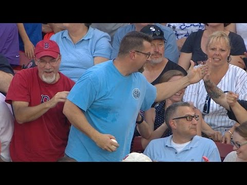 Fan reaches to haul in one-handed catch