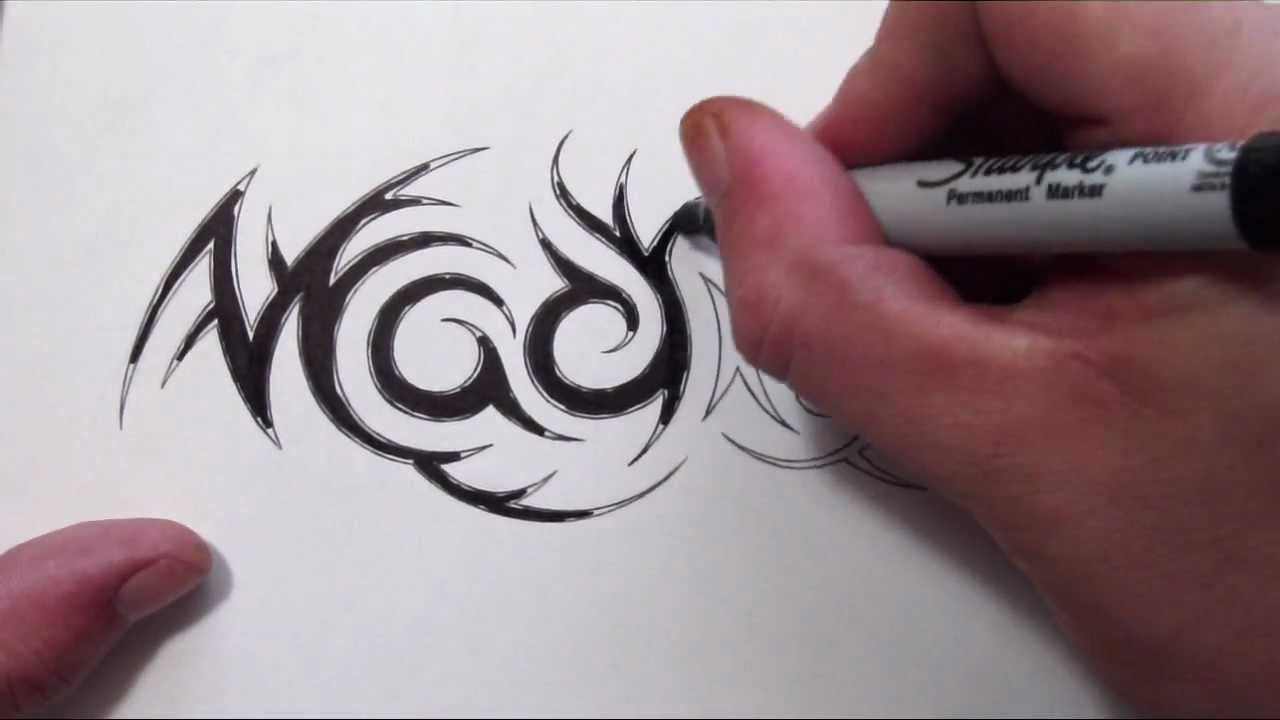 Tribal Name Tattoo Design: Custom Hidden Tribal Name Tattoo Design