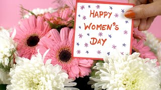 Beautiful pink and white flowers with a cute Happy Women's Day greeting card
