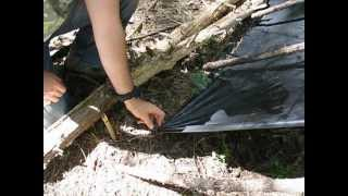 Repeat youtube video Prevent Tarp Gromets from Ripping Out & Survival Shelter Tips!