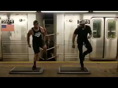 Englewood firefighter Tarrant Anderson, left, does trap aerobics on the NYC subway platform with friend Phillip Weeden.