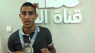 الملاكم الجزائري محمد فليسي العائد من الدوحة بقطر