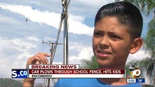 Car plows through North County school fence, hits kids