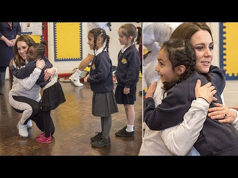 The heart-warming moment: Schoolchildren line up for Kate handshake - but hug royal instead