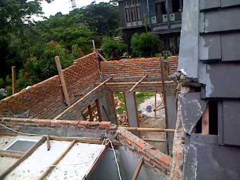 Renovasi rumah di bekasi atap dak jemuran talang air cor