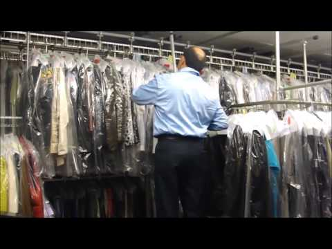 Using the conveyor belt at Tailor & Dry Cleaners in Yonkers, NY