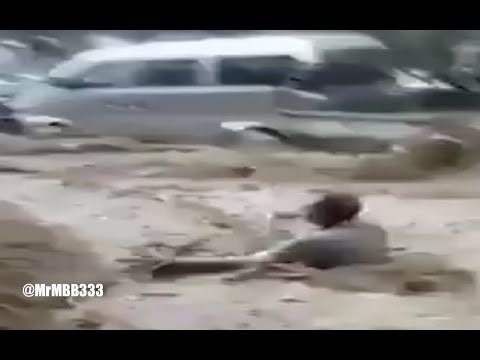 NEW - Flash flooding carries cars, furniture and a man through city streets!
