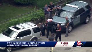Suspects connected to bank robbery surrender to SWAT team