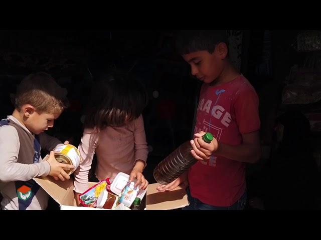 توزيع السلال الغذائية الطارئة و سلال النظافة في مخيم حاس (الضياء2)  - هيئة ساعد الخيرية