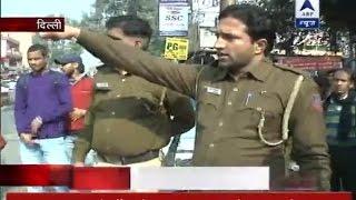 delhi cctv footage shows men harassing woman attacking cops