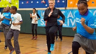 Pink Works Out With School Kids for UNICEF