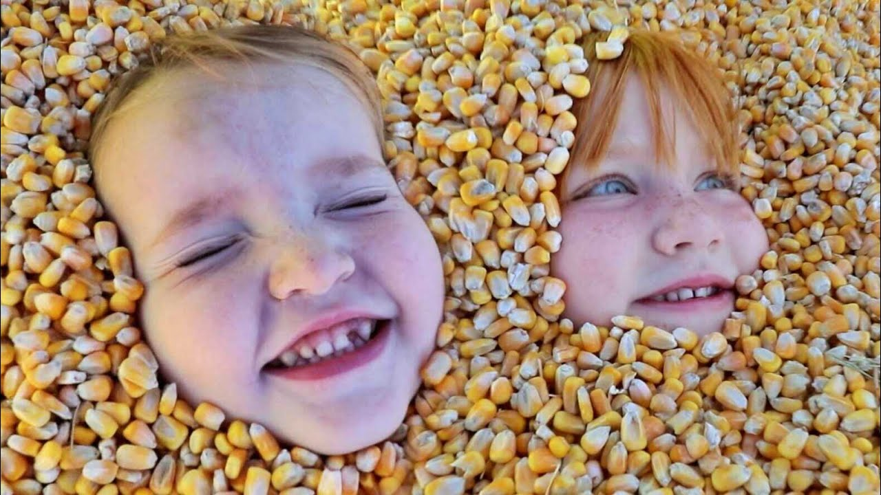 BURiED in CORN!!  Niko & Adley slide down Pumpkin Castle a family Halloween tradition and face paint