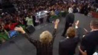 "Benny Hinn sings ""THERE IS A RIVER"""