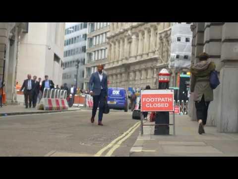 FOOTPATH CLOSED CITY OF LONDON BUSINESS MAN WALKING
