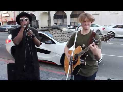 will.i.am surprises street performer