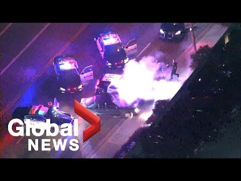 Police chase a vehicle with its hood blown up onto its windshield in Ladera Heights, California