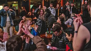 video: It's 'like VE Day': Watch as London's Soho is packed with drinkers enjoying a freedom pint