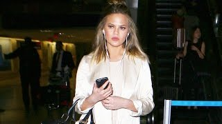 Chrissy Teigen Lands In LA Amid Fued With Piers Morgan