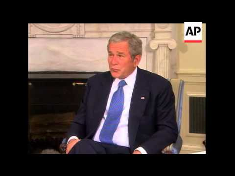 Bush calls on Musharraf to restore democracy