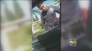 Caught On Tape: Officer Grabs For Woman's Cellphone As She's Recording Him