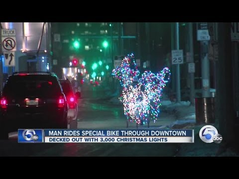 Tricycle with 3,000 Christmas lights peddles through Cleveland