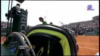 Rafael Nadal smiles after Matosevic knocked over his water bottles
