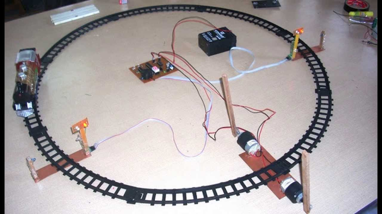 automatic railway gate control system using avr atmega8