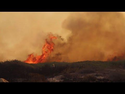 Raw: Calif. Fire Forces Evacuations Along Coast
