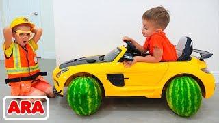 أطفال يركبون لعبة السيارات ويغيرون عجلات فيديو مضحك من فلاد ونيكيتا