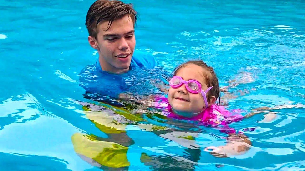 Mia is going to swim in the pool.  Nastya Artem Mia
