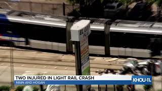 Two people injured in crash involving light rail train and car