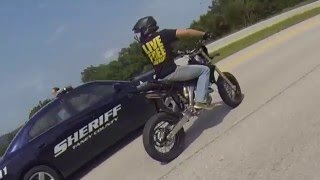 CRAZY STREETBIKER WHEELIES PAST COP, GETS CHASED, THEN CRASHES