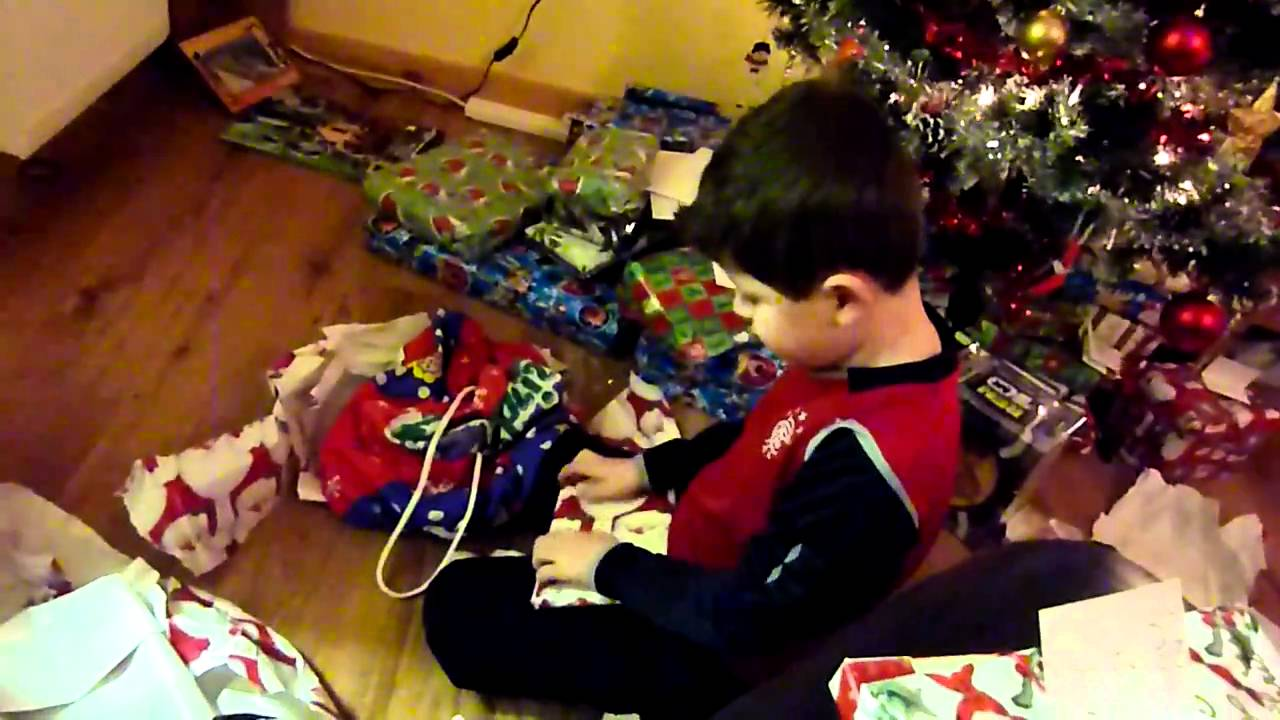 Daniel (age 7) opening Santa presents on Christmas Day 2010 - YouTube