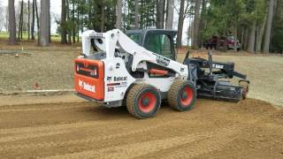 R&D paving grading with Bobcat A770 and grader attachment