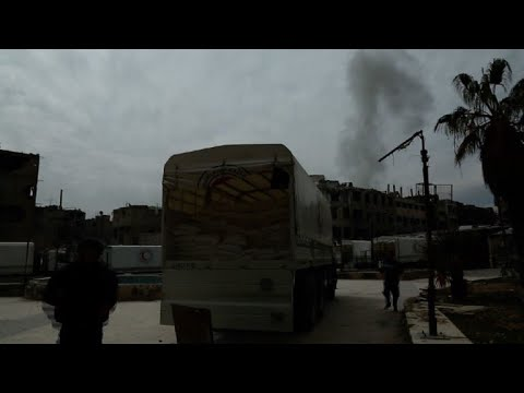 Syria aid convoy pauses temporarily as mortars hit nearby