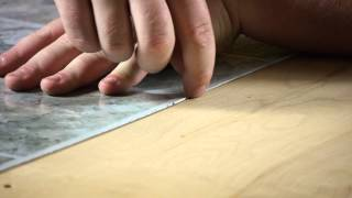 How to Install a Self-Adhesive Kitchen Floor : Working on Flooring