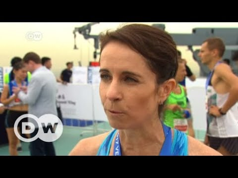 Athletes race up Beijing's tallest building | DW English