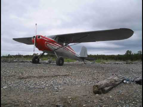 Cessna 120 flying in Alaska