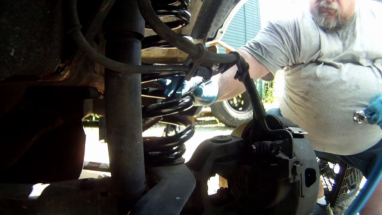 Part 2, 1999 Ford E150, Radius Arm-To-Axle Bolt Almost Fell Out And Coil  Spring Replacement
