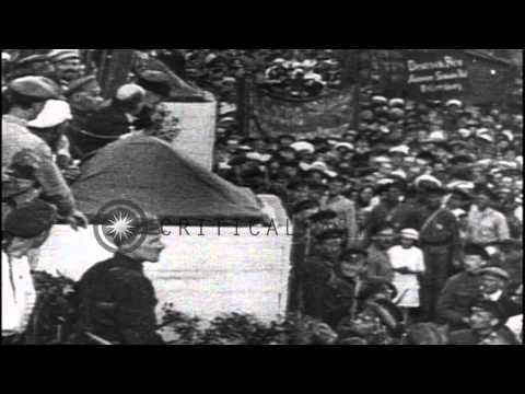 vladimir-lenin-addresses-a-large-crowd-at-the-red-square-and-sits-in-his-office-a...hd-stock-footage
