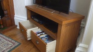 "Here I build a TV stand with dovetailed drawers from American White Oak. - http://tinyurl.com/sew-tvstand Music Credits: ""I Got You"","