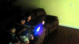 Kids playing time crisis ps3 move