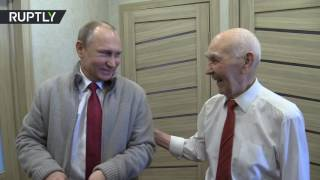 Putin visits his former KGB boss on his 90th birthday