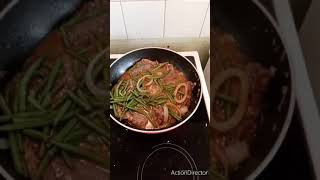 Sirloin steaks Green beans onions & pepper longside rice