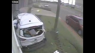 Surveillance Video Shows Dramatic Bus Crash
