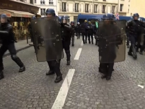 Raw: Police Clash With Protesters in Paris