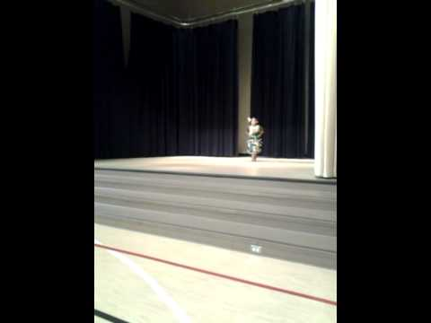 Kayla performs at Hartvigsen school